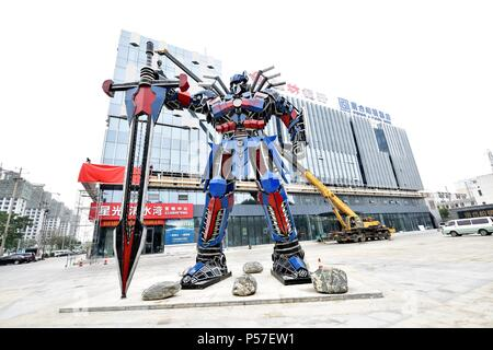 Liaochen, Liaochen, China. 25th June, 2018. Liaocheng, CHINA-25th June 2018: A sculpture of transformer made of recycled auto parts can be seen in Liaocheng, east China's Shandong Province. Credit: SIPA Asia/ZUMA Wire/Alamy Live News - Stock Photo
