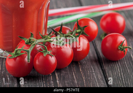 Cherry tomatoes and glass of tomato - Stock Photo