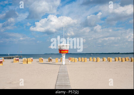 Empty sandy beach with DLRG monitoring tower and beach chairs, Travemünde, Baltic Sea, Schleswig-Holstein, Germany - Stock Photo