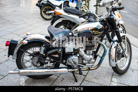 Bullet 500, Royal Enfield classic motorbike parked on pavement, France, Europe - Stock Photo