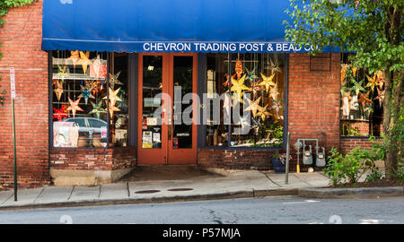 ASHEVILLE, NC, USA-24 JUNE 18: The Chevron Trading Post & Bead Co., in downtown Ashevile, with a bright collection of large beaded stars in the window - Stock Photo