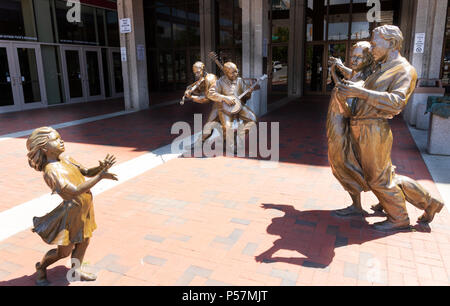 ASHEVILLE, NC, USA-24 JUNE 18: Sculptures at the front of the Thomas Wolfe Auditorium in Asheville, NC, USA. - Stock Photo