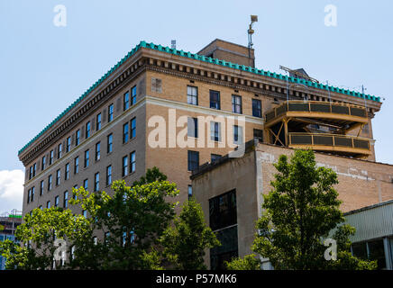 ASHEVILLE, NC, USA-24 JUNE 18: The rear of the 1926 flatiron building, a retail and office building at Battery Park and Wall Streets. - Stock Photo