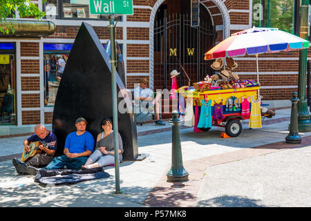 ASHEVILLE, NC, USA-24 JUNE 18: Musicians, and a cart vendor on a sunny day at the iconic flat iron, across from the flat iron building at Battery Park - Stock Photo