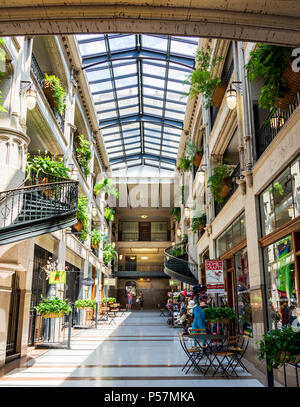 ASHEVILLE, NC, USA-24 JUNE 18: A hallway inside the Grove Arcade, featuring a variety of small shops. - Stock Photo