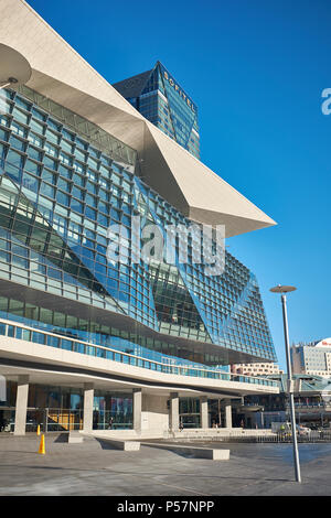 Exterior view of The International Convention Centre Sydney with the Sofitel Hotel behind with a cloudless sky, Darling Harbour, Sydney, Australia - Stock Photo