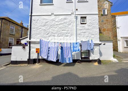 washing line hanging in the street,St ives,Cornwall,England,UK - Stock Photo