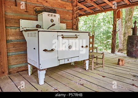 Vintage antique wrought iron wood or coal burning stove made by Home Comfort, circa 1864 located in rural Alabama. - Stock Photo