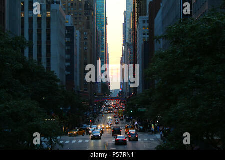 NEW YORK, NY - JULY 10: Best shots of partiall failed Manhattanhenge taken atop Tudor City overpass, Manhattan on JULY 10th, 2017 in New York, USA. (P - Stock Photo