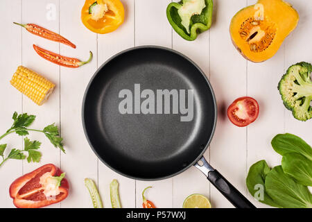 Fresh fruits and vegetables vintage border and empty frypan - Stock Photo