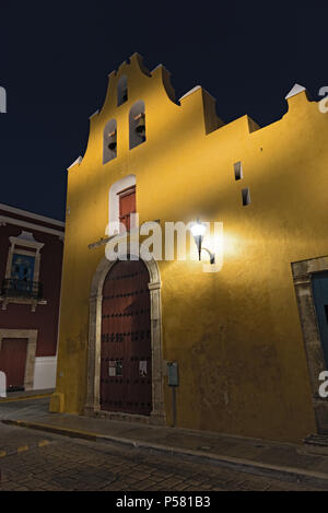yellow church in colonial style at night in san francisco de campeche, mexico - Stock Photo