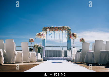wedding decorations from flowers and a wedding arch for the ceremony - Stock Photo