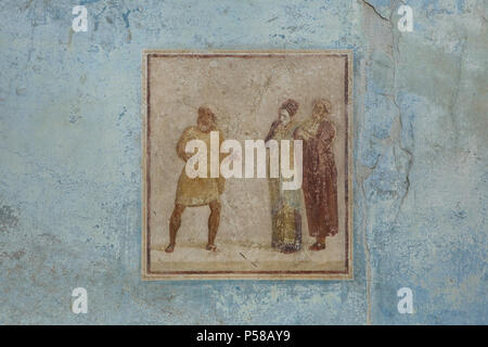 Theatrical scene depicted in the fresco in the third style in the atrium of the House of Casca Longus (Casa di Casca Longus) in the archaeological site of Pompeii (Pompei) near Naples, Campania, Italy. - Stock Photo