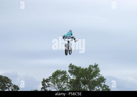 Aerial motocross stunt - Stock Photo