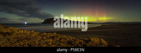 Aurora Australis over moonlit beach - Stock Photo