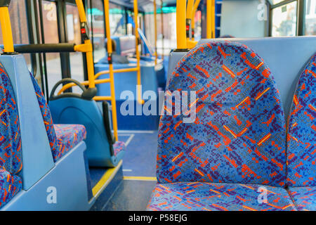 Interior view of a bus with empty seat at London, United Kingdom - Stock Photo