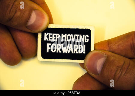 Word writing text Keep Moving Forward Motivational Call. Business concept for Optimism Progress Persevere Move Two hands hold small black card focused - Stock Photo