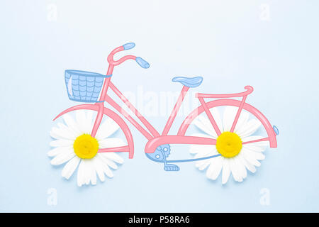 Creative concept photo of illustrated bike with chamomile flowers wheels on blue background. - Stock Photo