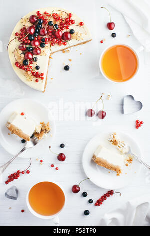 New York cheese cake with berries on white wooden table. Angle view. - Stock Photo