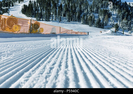 The game of shadows on the modified slopes in the Dolomites. Empty ski slope in winter on a sunny day. Prepare ski slope. Val di Fiemme - Stock Photo