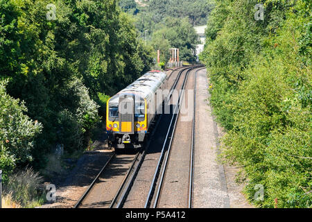 Holton Heath Station, Dorset, UK.  26th June 2018. UK Weather.   A London bound train at Holton Heath with delays on South Western Railways in Dorset after a small fire under a train between Surbiton and Weybridge blocked the West bound line.  This incident is on top of the speed restrictions on the railways due to the risk of the lines buckling due to the hot temperatures from the current heatwave.  Picture Credit: Graham Hunt/Alamy Live News - Stock Photo