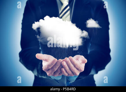 Business and sustainable concept.Businessman holding a rainy cloud - Stock Photo