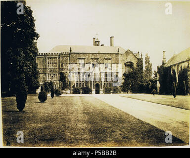 N/A. English: Brympton d'Evercy (also known as Brympton House), a manor house near Yeovil in the county of Somerset, England. Front entrance. circa 1860. Anon. But uploaded by R. de Salis, meRodolph2 (talk) 00:33, 24 July 2014 (UTC) 244 Brympton entrance front 1860 - Stock Photo
