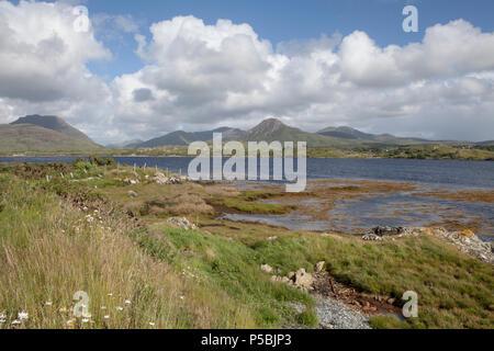 Looking towards the Twelve Bens (or Twelve Pins) Mountains from the Connemara Loop Road on the Renvyle Peninsula - Stock Photo
