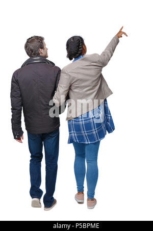 Back view of going interracial couple. walking friendly girl and guy holding hands. Rear view people collection. backside view of person. Isolated ove - Stock Photo