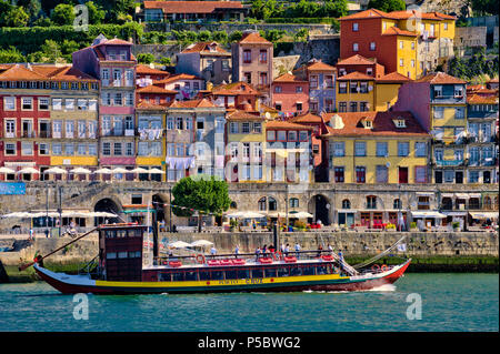 The Ribeira district of Oporto, with a traditional excursion barge (barco de rabelo) - Stock Photo
