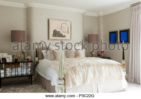 Four poster bed in country style bedroom - Stock Photo