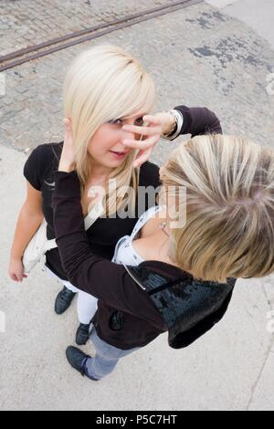 Helping hand girl girls females friends girlfriends - Stock Photo