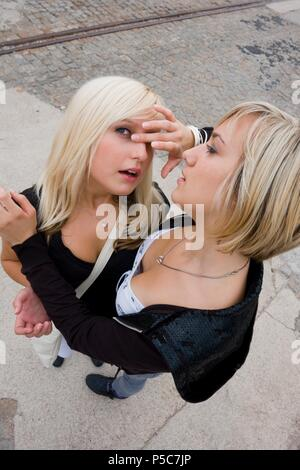 Helping hand girl girls females friends girlfriends compassion - Stock Photo