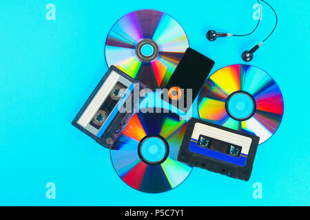 The concept of the evolution of music. Cassette, CD-disk, mp3 player. Vintage and modernity. Music support - Stock Photo
