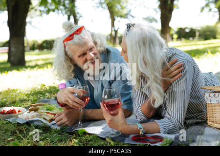 Delighted nice couple having a conversation - Stock Photo