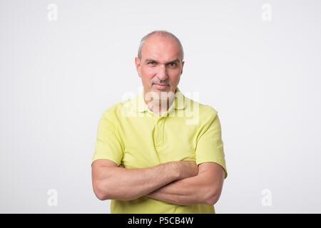 Portrait of mature sad man. He had bad mood. - Stock Photo