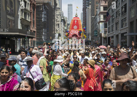 People numbering in the thousands fill 5th Avenue in Manhattan for the 'Festival of the Chariots.' 'Ratha-yatra, or the Festival of Chariots, is a joyous event celebrated for thousands of years in the Indian holy city of Jagannatha Puri, and more recently by Hare Krishna devotees in cities around the world. - Stock Photo