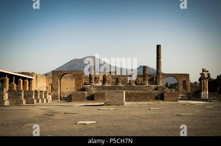 A sunny morning in the empty forum of ancient Pompeii, Italy in the shadow of Mount Vesuvius - Stock Photo
