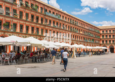 Plaza Corredera cafe, view of cafes in the Plaza de la Corredera in the center of Cordoba old town on a summer afternoon, Cordova, Andalucia, Spain. - Stock Photo