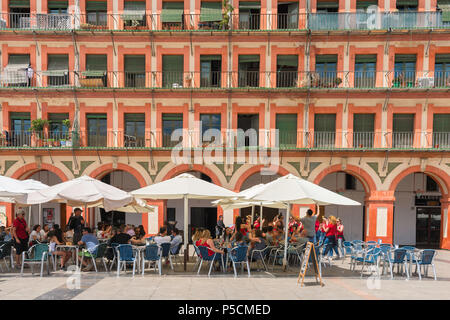 Cordoba Spain, view of a cafe terrace in the 17th Century Plaza de la Corredera in the center of Cordoba on a summer afternoon, Andalucia, Spain. - Stock Photo