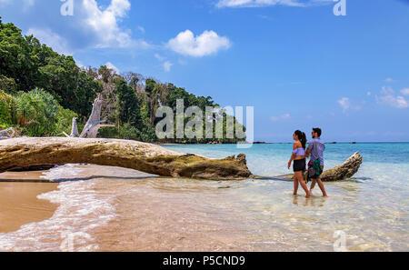 Indian honeymoon couple enjoy a romantic moment at the scenic Jolly Buoy island, Andaman India. - Stock Photo
