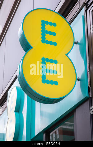 The EE logo on the front of one of it's stores. - Stock Photo