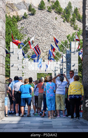 MOUNT RUSHMORE, KEYSTONE, SOUTH DACOTA, USA - JULY 20, 2017: Group of tourists entering Mount Rushmore National Monument and taking pictures. - Stock Photo
