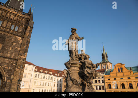 St. Ivo statue on the Charles Bridge with Old Town Bridge Tower, Prague, Czech Republic - Stock Photo