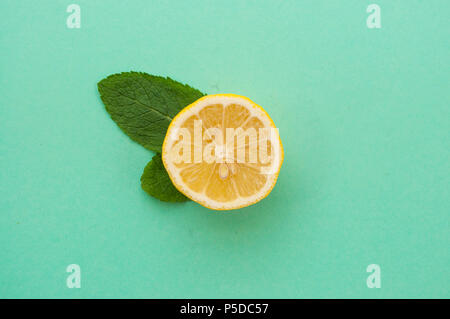 Flat lay of cut lemon and mint leaves ingredients. - Stock Photo