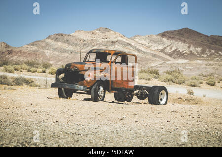 Classic view of an old rusty pickup truck car wreck in the desert on a beautiful sunny day with blue sky in summer with retro vintage VSCO Instagram s - Stock Photo