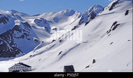 The Great St Bernard Pass in Switzerland looking into Italy with the Mt Fourchon in the background - Stock Photo