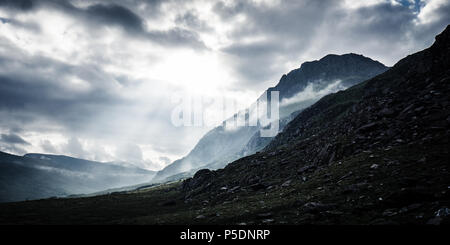 Mountains in Snowdonia during a morning of dramatic weather - Stock Photo