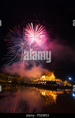 Fireworks celebrate the New Year 2018 at Rajapruek Royal Park, Chiang Mai with beutiful light of Hor Khum Luang temple,Thai Tradition Building. - Stock Photo