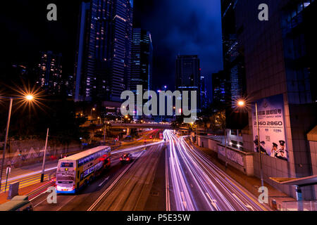 HONG KONG - JUNE 02, 2018: Light trails of traffic at night in central Hong Kong - Stock Photo